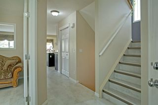 Photo 3: 202 Cougar Plateau Way SW in Calgary: Cougar Ridge Detached for sale : MLS®# A1029793