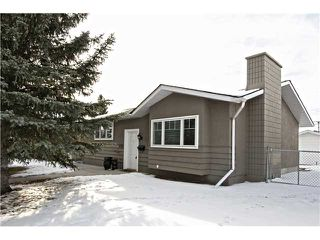 Photo 1: 5712 LODGE Crescent SW in Calgary: Lakeview Residential Detached Single Family for sale : MLS®# C3648938
