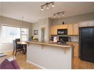 Photo 7: 89 TUSSLEWOOD Drive NW in Calgary: Tuscany House for sale : MLS®# C3650937