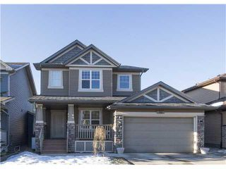 Photo 1: 89 TUSSLEWOOD Drive NW in Calgary: Tuscany House for sale : MLS®# C3650937