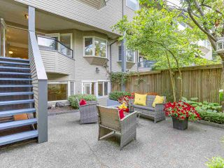 "Photo 1: 2411 W 1ST Avenue in Vancouver: Kitsilano Townhouse for sale in ""Bayside Manor"" (Vancouver West)  : MLS®# R2191405"