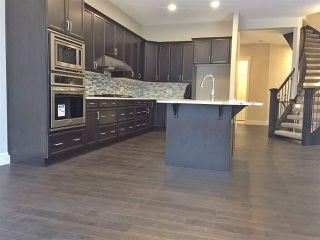Photo 7: 7105 BANNOCK Bay in Edmonton: Zone 27 House for sale : MLS®# E4141056