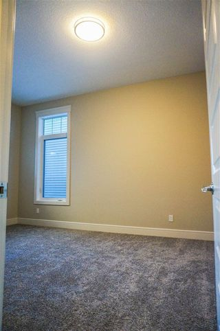 Photo 4: 7105 BANNOCK Bay in Edmonton: Zone 27 House for sale : MLS®# E4141056