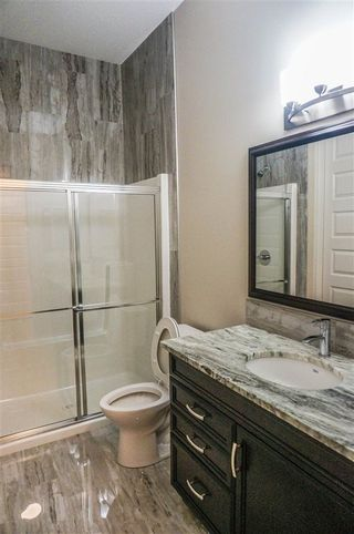 Photo 11: 7105 BANNOCK Bay in Edmonton: Zone 27 House for sale : MLS®# E4141056