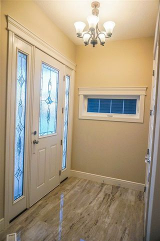 Photo 3: 7105 BANNOCK Bay in Edmonton: Zone 27 House for sale : MLS®# E4141056