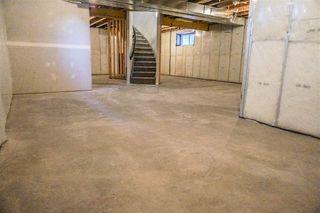 Photo 24: 7105 BANNOCK Bay in Edmonton: Zone 27 House for sale : MLS®# E4141056