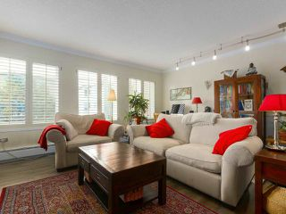 "Photo 1: 103 222 N TEMPLETON Drive in Vancouver: Hastings Condo for sale in ""CAMBRIDGE COURT"" (Vancouver East)  : MLS®# R2383049"
