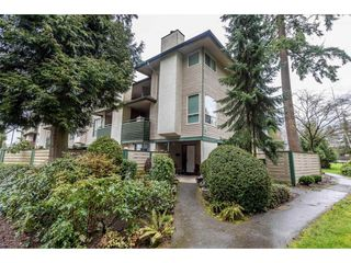 """Photo 1: 14839 HOLLY PARK Lane in Surrey: Guildford Townhouse for sale in """"Holly Park Lane"""" (North Surrey)  : MLS®# R2154252"""