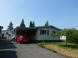"Photo 1: 138 3665 244 Street in Langley: Otter District Manufactured Home for sale in ""LANGLEY GROVE ESTATES"" : MLS®# R2306530"