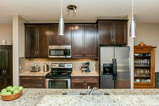 Photo 8: 1048 GAULT Boulevard NW in Edmonton: Zone 27 Townhouse for sale : MLS®# E4134587