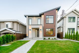 Photo 1: 7693 BURGESS Street in Burnaby: Edmonds BE House for sale (Burnaby East)  : MLS®# R2342093