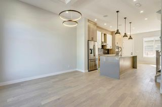 Photo 7: 4015 10 Avenue SW in Calgary: Rosscarrock Row/Townhouse for sale : MLS®# A1037968