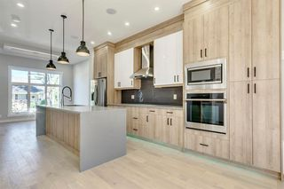 Photo 12: 4015 10 Avenue SW in Calgary: Rosscarrock Row/Townhouse for sale : MLS®# A1037968