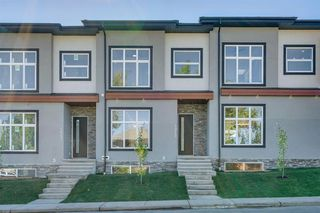 Photo 3: 4015 10 Avenue SW in Calgary: Rosscarrock Row/Townhouse for sale : MLS®# A1037968