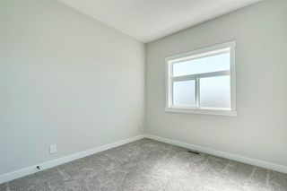 Photo 25: 4015 10 Avenue SW in Calgary: Rosscarrock Row/Townhouse for sale : MLS®# A1037968