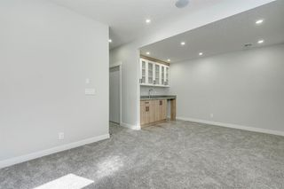 Photo 34: 4015 10 Avenue SW in Calgary: Rosscarrock Row/Townhouse for sale : MLS®# A1037968