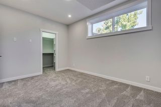 Photo 35: 4015 10 Avenue SW in Calgary: Rosscarrock Row/Townhouse for sale : MLS®# A1037968
