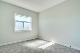 Photo 28: 4015 10 Avenue SW in Calgary: Rosscarrock Row/Townhouse for sale : MLS®# A1037968