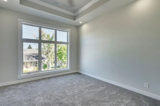 Photo 19: 4015 10 Avenue SW in Calgary: Rosscarrock Row/Townhouse for sale : MLS®# A1037968