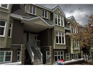 "Photo 1: 2261 HEATHER Street in Vancouver: Fairview VW Townhouse for sale in ""THE FOUNTAINS"" (Vancouver West)  : MLS®# V888051"