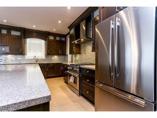 "Photo 10: 7687 211B Street in Langley: Willoughby Heights House for sale in ""Yorkson"" : MLS®# F1405632"