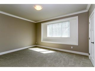 "Photo 11: 7687 211B Street in Langley: Willoughby Heights House for sale in ""Yorkson"" : MLS®# F1405632"