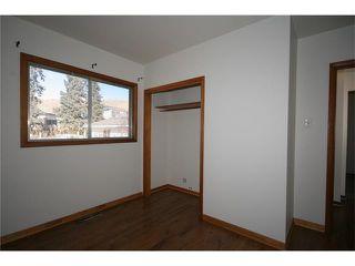 Photo 11: 112 POWELL Street: Cochrane House for sale : MLS®# C4052948