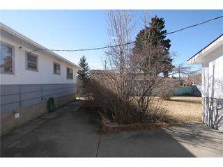 Photo 18: 112 POWELL Street: Cochrane House for sale : MLS®# C4052948