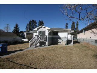 Photo 1: 112 POWELL Street: Cochrane House for sale : MLS®# C4052948