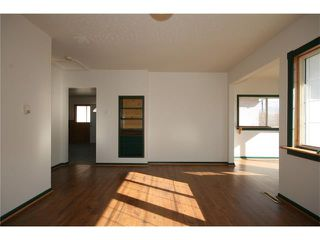 Photo 9: 112 POWELL Street: Cochrane House for sale : MLS®# C4052948