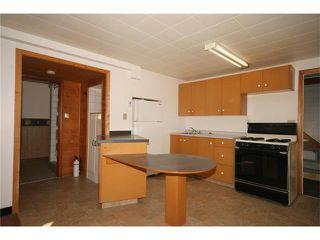 Photo 15: 112 POWELL Street: Cochrane House for sale : MLS®# C4052948