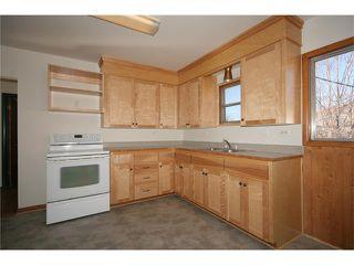 Photo 5: 112 POWELL Street: Cochrane House for sale : MLS®# C4052948