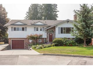 Photo 1: 319 MOUNT ROYAL Place in Port Moody: College Park PM House for sale : MLS®# R2298047