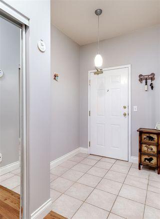 "Photo 3: 107 12155 191B Street in Pitt Meadows: Central Meadows Condo for sale in ""Edge Park Manor"" : MLS®# R2357824"