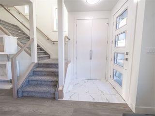Photo 2: 8831 92 Street in Edmonton: Zone 18 House Half Duplex for sale : MLS®# E4177601