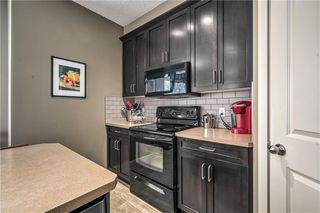 Photo 11: 209 Rainbow Falls Drive: Chestermere House for sale : MLS®# C4286595