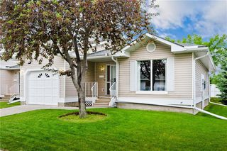 Photo 2: 132 DEER RIDGE Close SE in Calgary: Deer Ridge Semi Detached for sale : MLS®# C4303155