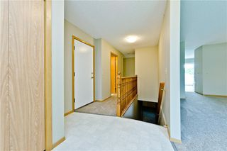 Photo 18: 132 DEER RIDGE Close SE in Calgary: Deer Ridge Semi Detached for sale : MLS®# C4303155
