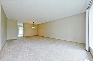 Photo 19: 132 DEER RIDGE Close SE in Calgary: Deer Ridge Semi Detached for sale : MLS®# C4303155