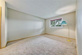 Photo 12: 132 DEER RIDGE Close SE in Calgary: Deer Ridge Semi Detached for sale : MLS®# C4303155