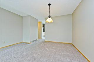 Photo 5: 132 DEER RIDGE Close SE in Calgary: Deer Ridge Semi Detached for sale : MLS®# C4303155