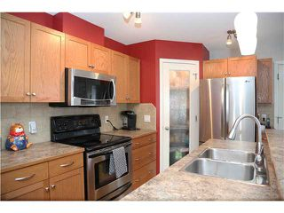 Photo 2: 575 STONEGATE Way NW: Airdrie Residential Attached for sale : MLS®# C3617598