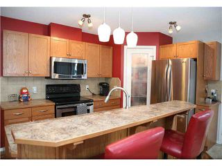 Photo 3: 575 STONEGATE Way NW: Airdrie Residential Attached for sale : MLS®# C3617598