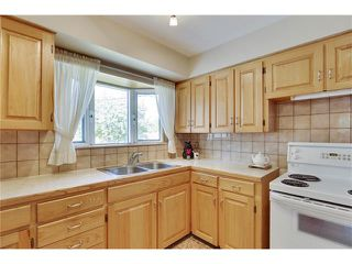 Photo 9: 129 FAIRVIEW Crescent SE in Calgary: Fairview House for sale : MLS®# C4062150