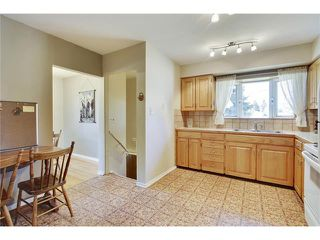 Photo 12: 129 FAIRVIEW Crescent SE in Calgary: Fairview House for sale : MLS®# C4062150