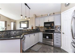 Photo 9: 208 MT ABERDEEN Circle SE in Calgary: McKenzie Lake House for sale : MLS®# C4067845
