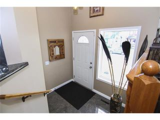 Photo 2: 208 MT ABERDEEN Circle SE in Calgary: McKenzie Lake House for sale : MLS®# C4067845