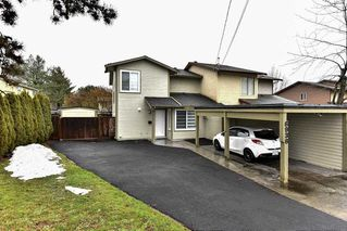 Photo 1: 6936 134 STREET in Surrey: West Newton House 1/2 Duplex for sale : MLS®# R2151866
