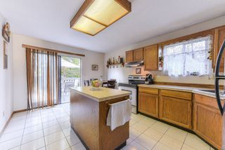 """Photo 5: 1119 HANSARD Crescent in Coquitlam: Ranch Park House for sale in """"RANCH PARK"""" : MLS®# R2368526"""