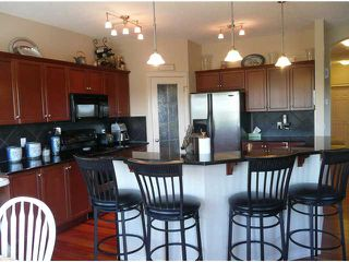 Photo 4: 70 ROCKYSPRING Circle NW in CALGARY: Rocky Ridge Ranch Residential Detached Single Family for sale (Calgary)  : MLS®# C3493243